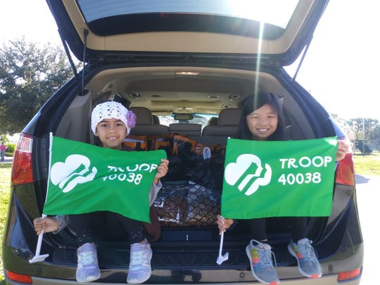 Girl Scout Troop 40038 members Jordy Vargas, left, and Lilly O'Neill helped host a Thanksgiving food drive for Family Meals Inc.
