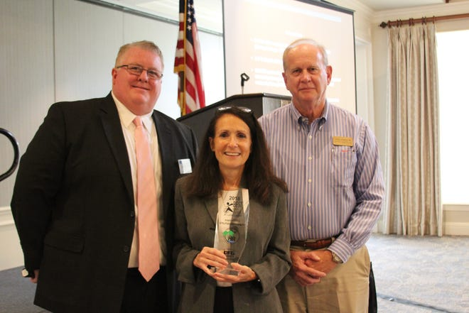 From left, Douglas Baber, president of the SLCHRA, with Lois Wolfe, FPUA Human Resources Manager and John Tompeck, FPUA Director of Utilities accepting 2018 Best Places to Work award.