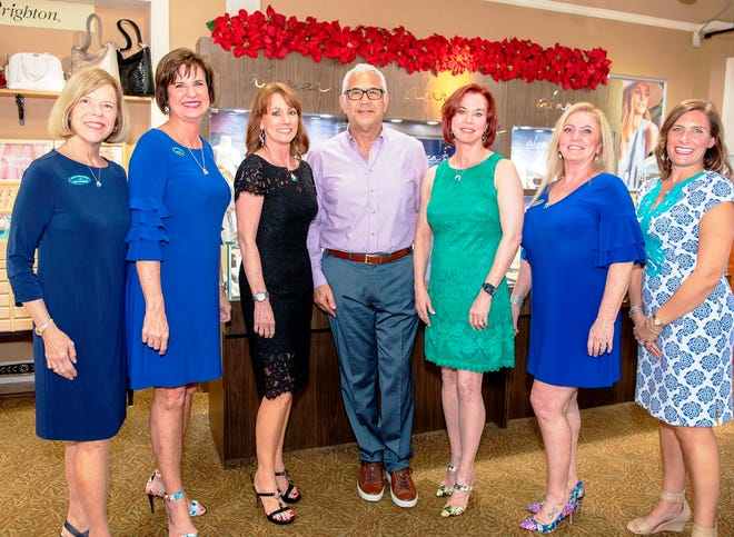 From left, CWH Board Member Mona Salisbury, CWH Board President Janice Norman, Argento owner Liliann Petersen, Lifeguards President Tony Barletta, CWH Founder Lynne Barletta and Board Members Candace Lopes and Kelly Laurine at the Argento Jewelry event to benefit Catch the Wave of Hope.