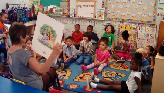 Community volunteer reads to children during Head Start Community Read Week. School districts across the Treasure Coast are encouraging families to participate in the census, which provides federal funds to programs such as Head Start.