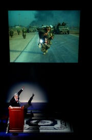 Oliver North spoke to a packed auditorium at the Riverside Theatre in Vero Beach as part of the theater's 2005 Distinguished Lecturer Series. Included in his speech was a segment in which he used his own photos to help describe what was happening in Iraq, and to give his opinion of the troops. Here he talks about an American soldier he witnessed carrying an injured Iraqi soldier to a helicopter to get medical attention.