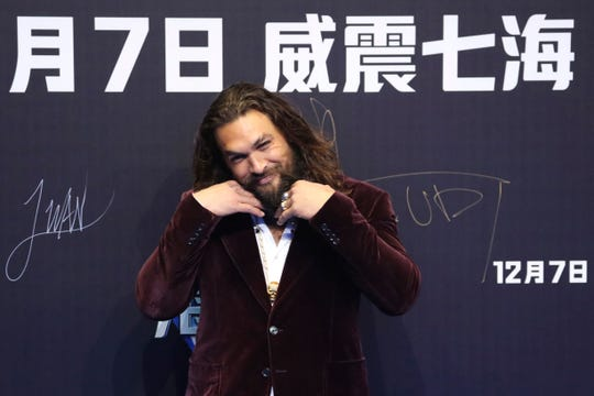 "Actor Jason Momoa poses for a photo during the red carpet event ahead of the ""Aquaman"" movie's world premiere in Beijing, China, Sunday, Nov. 18, 2018."