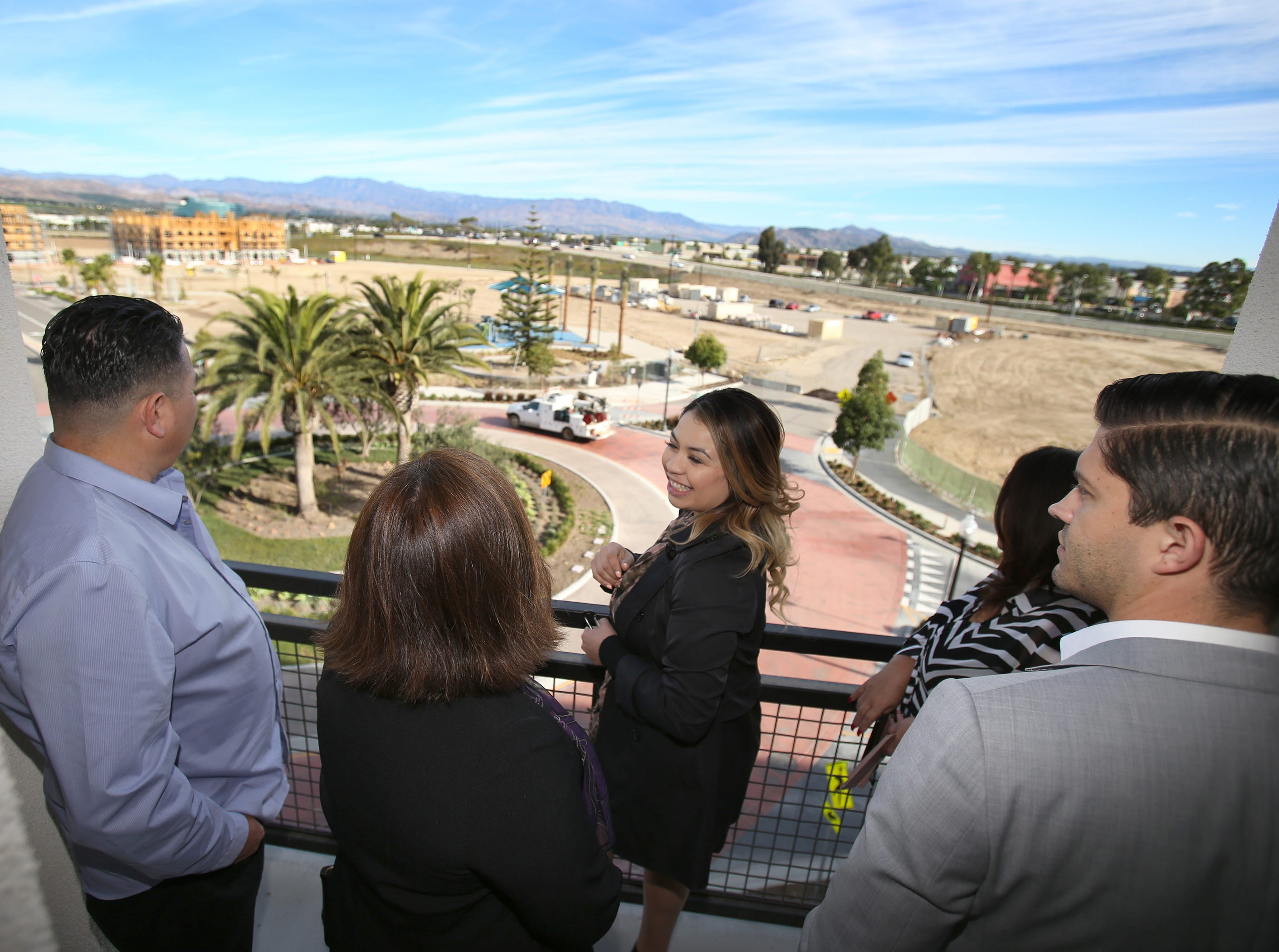 Samantha Martinez, assistant manager for The Junction at the Wagon Wheel, shows guests the view from one of its fourth-floor units. The new apartment complex began renting in Ocotber.