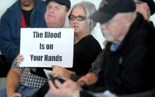 Sheri Cecil holds a sign during a discussion about gun shows last year at the Ventura County Fairgrounds.