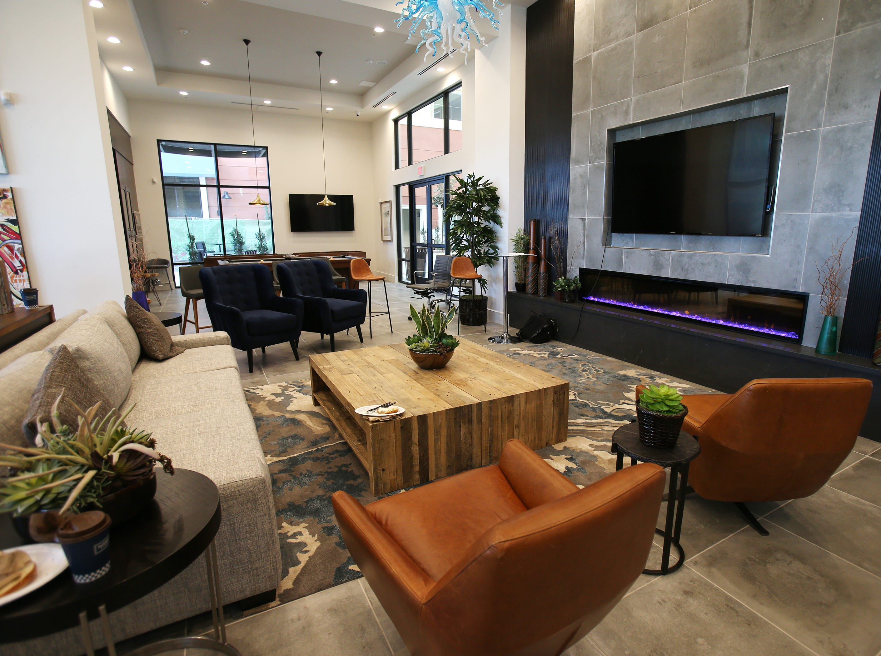 The Junction at Wagon Wheel apartment complex has a community room. It includes a meeting room, a kitchen area and a pool table.