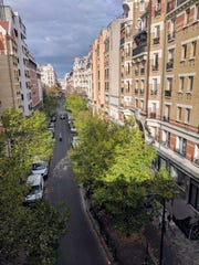 Looking down on a tree-lined Parisian neighborhood from the Promenade Plantée, a three-mile-long landscaped walking path that was once an elevated railway through part of Paris.