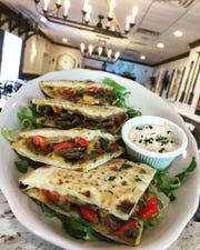 The Marcos, a Greek Mediterranean flatbread from Pappous Greek Kitchen in Yorktown Heights.  The entree is made of Greek Kasseri cheese, sautéed onions, red and green peppers and a choice of a chicken or regular gyro sandwich served with smoked tzatziki sauce.