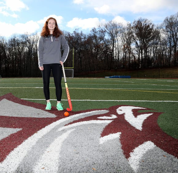Albertus Magnus senior Mary O'Connor on the field with the falcon mascot in New City. O'Connor is the Rockland field hockey player of the year.