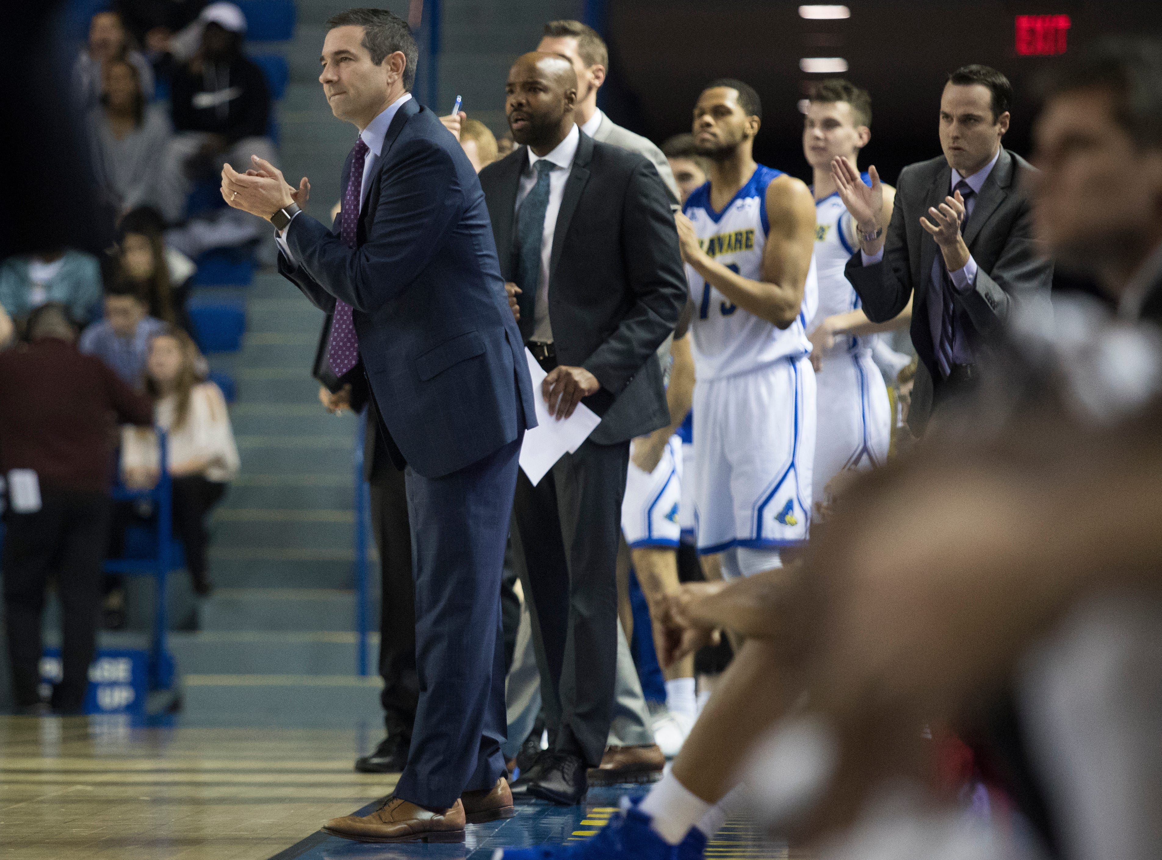 Delaware head coach Martin Ingelsby applauds his team Monday at the Bob Carpenter Center. Delaware defeated Louisiana Tech 75-71.