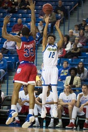 Delaware's Ithiel Horton (12) shoot a three-pointer while being guarded by Louisiana Tech's Oliver Powell.