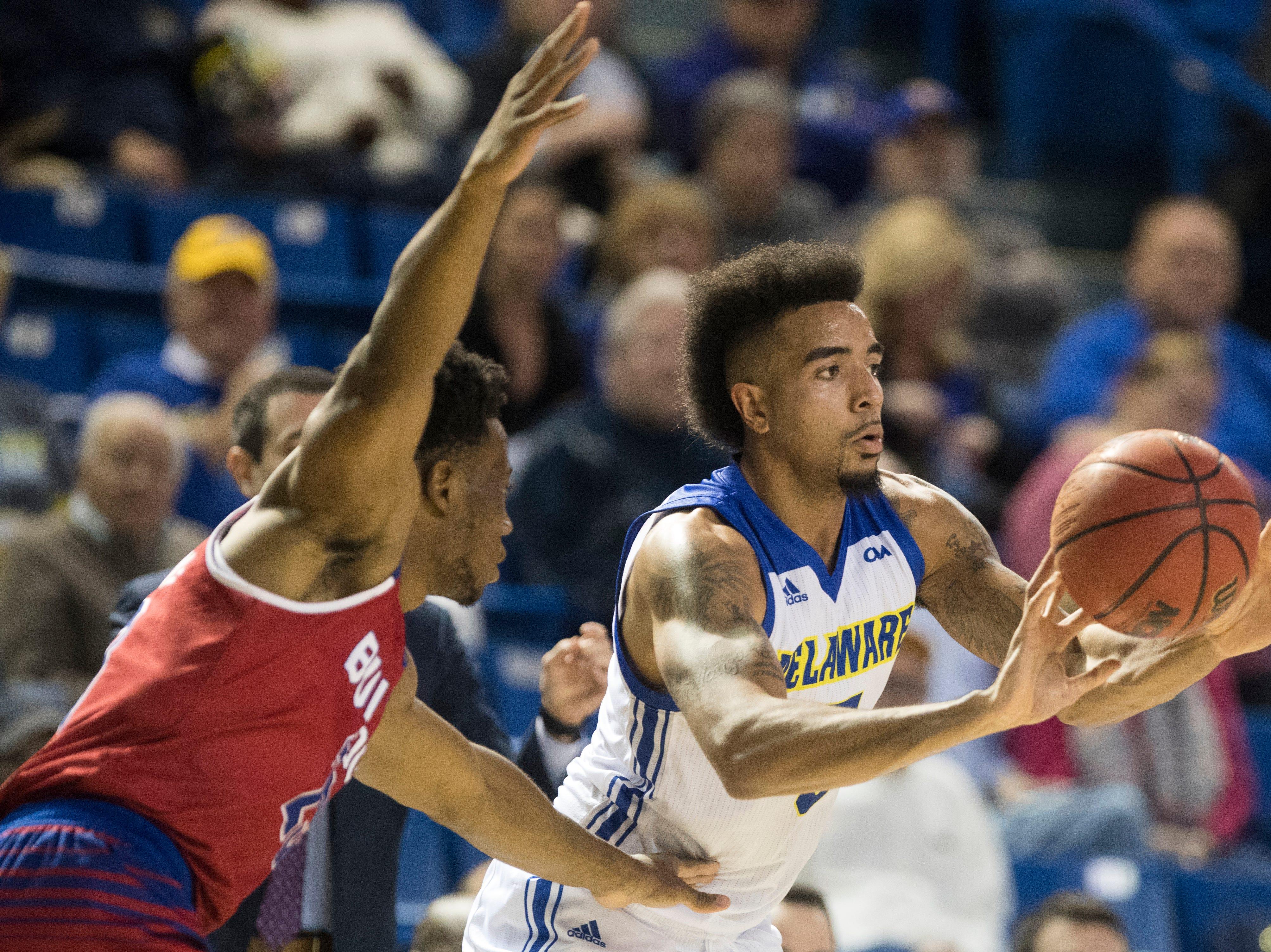 Delaware's Eric Carter passes to a teammate Monday at the Bob Carpenter Center. Delaware defeated Louisiana Tech 75-71.