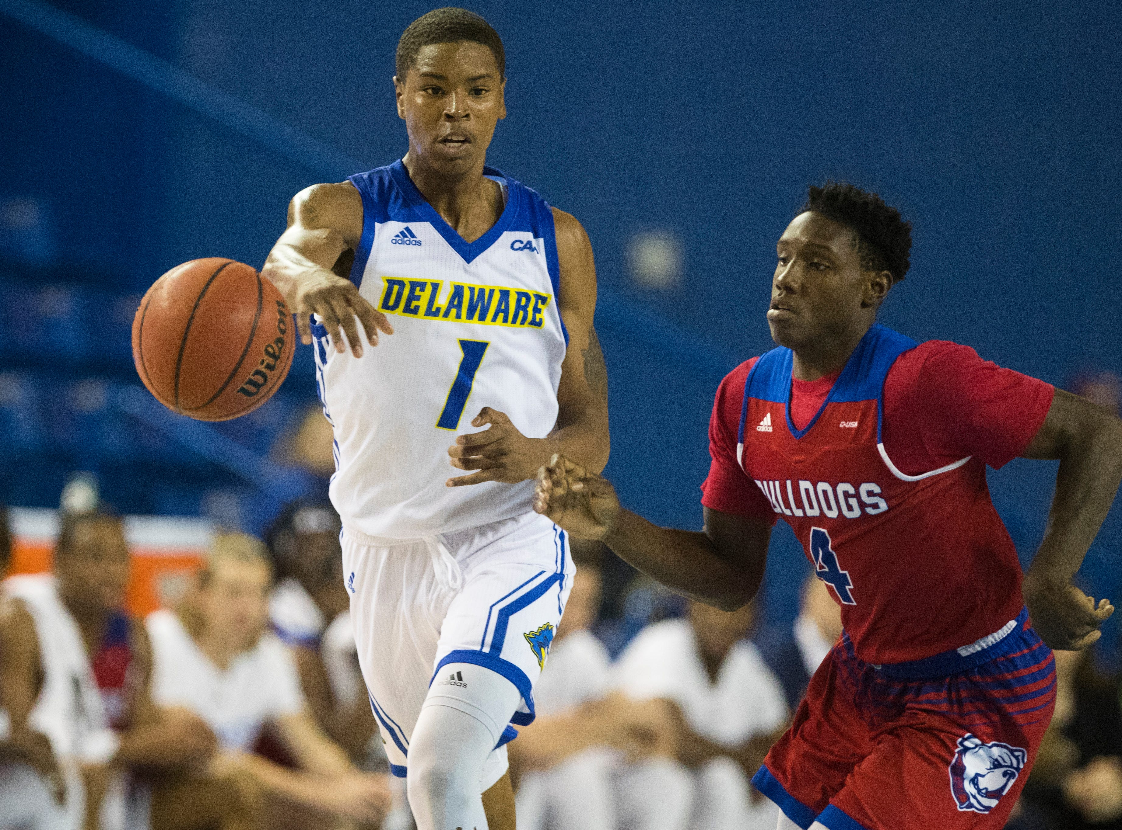 Delaware's Kevin Anderson (1) passes to a teammate Monday at the Bob Carpenter Center. Delaware defeated Louisiana Tech 75-71.