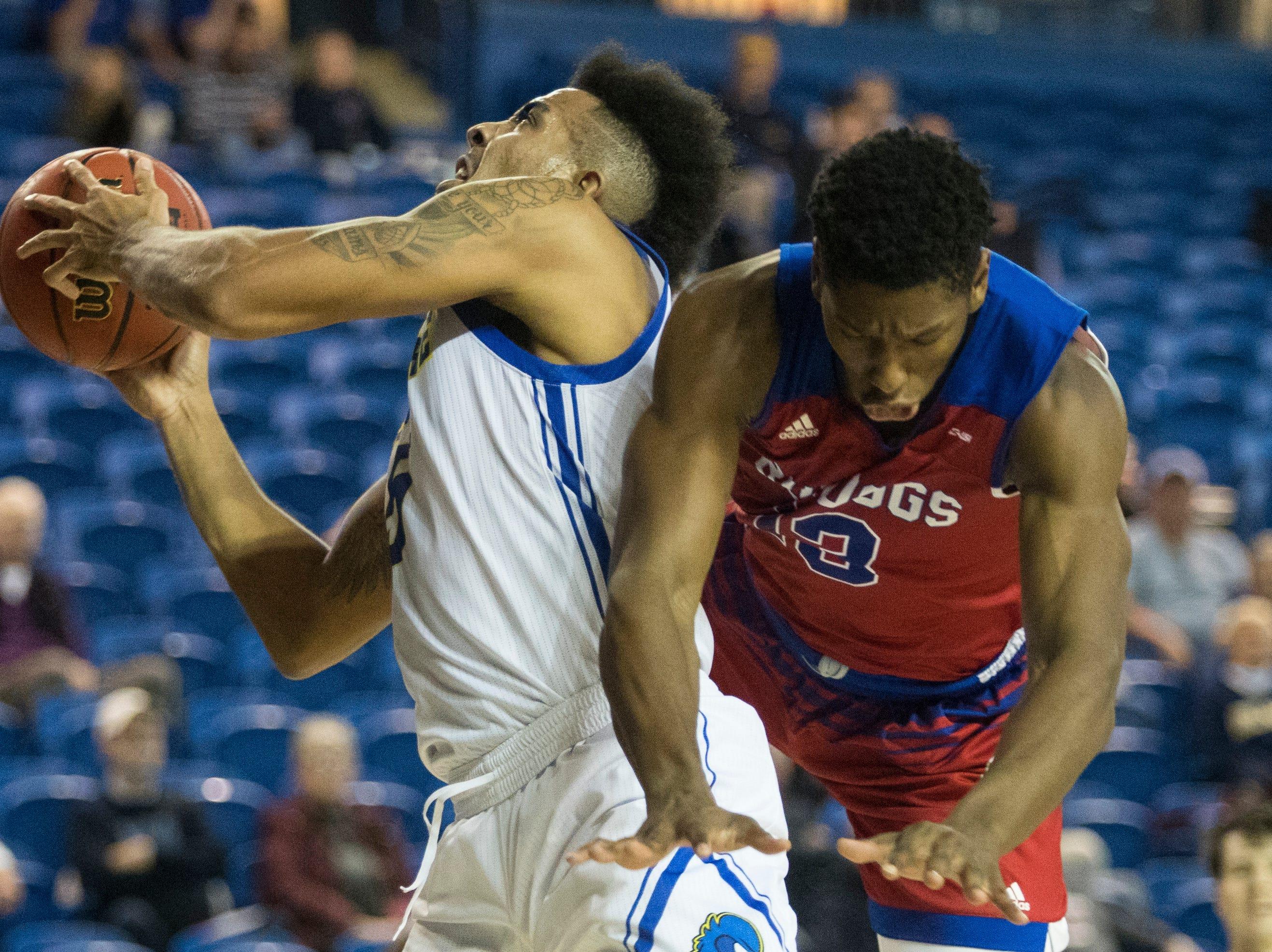 Delaware's Eric Carter (5) grabs a rebound Monday at the Bob Carpenter Center. Delaware defeated Louisiana Tech 75-71.