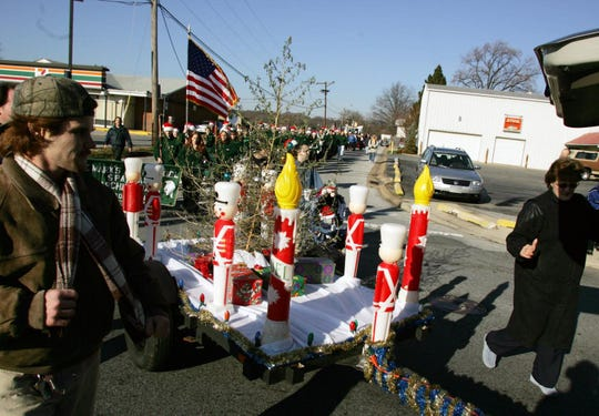 The Christmas weed gets a ride down Philadelphia Pike in this 2006 photo.