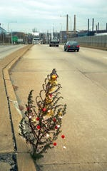 A photo of the original Christmas Weed that a News Journal photographer spied growing out of crack in Claymont near I-495. It appeared on the front page on Dec. 17, 1993.