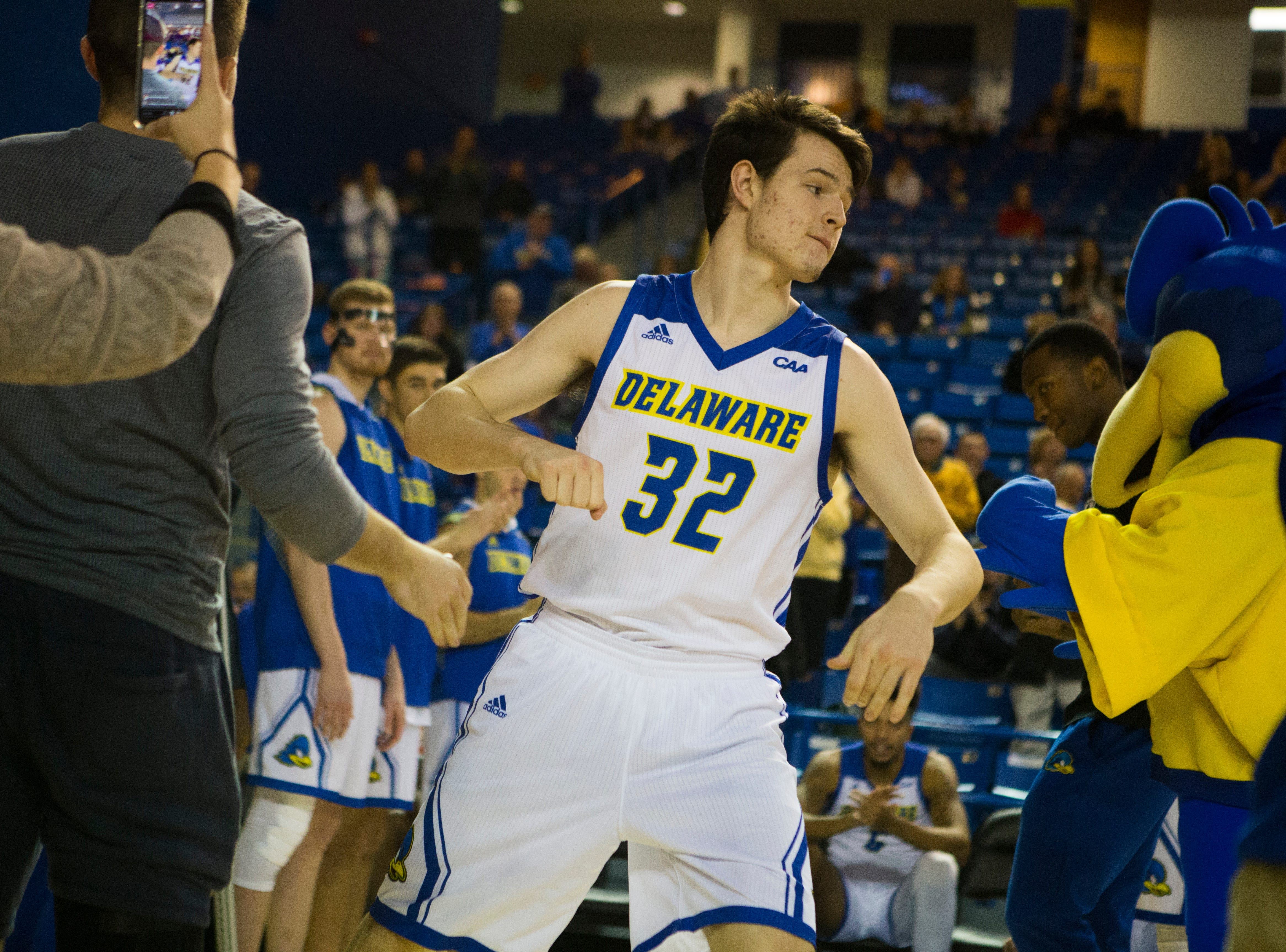 Delaware's Matt Veretto (32) takes to the court before they face Louisiana Tech Monday at the Bob Carpenter Center. Delaware defeated Louisiana Tech 75-71.