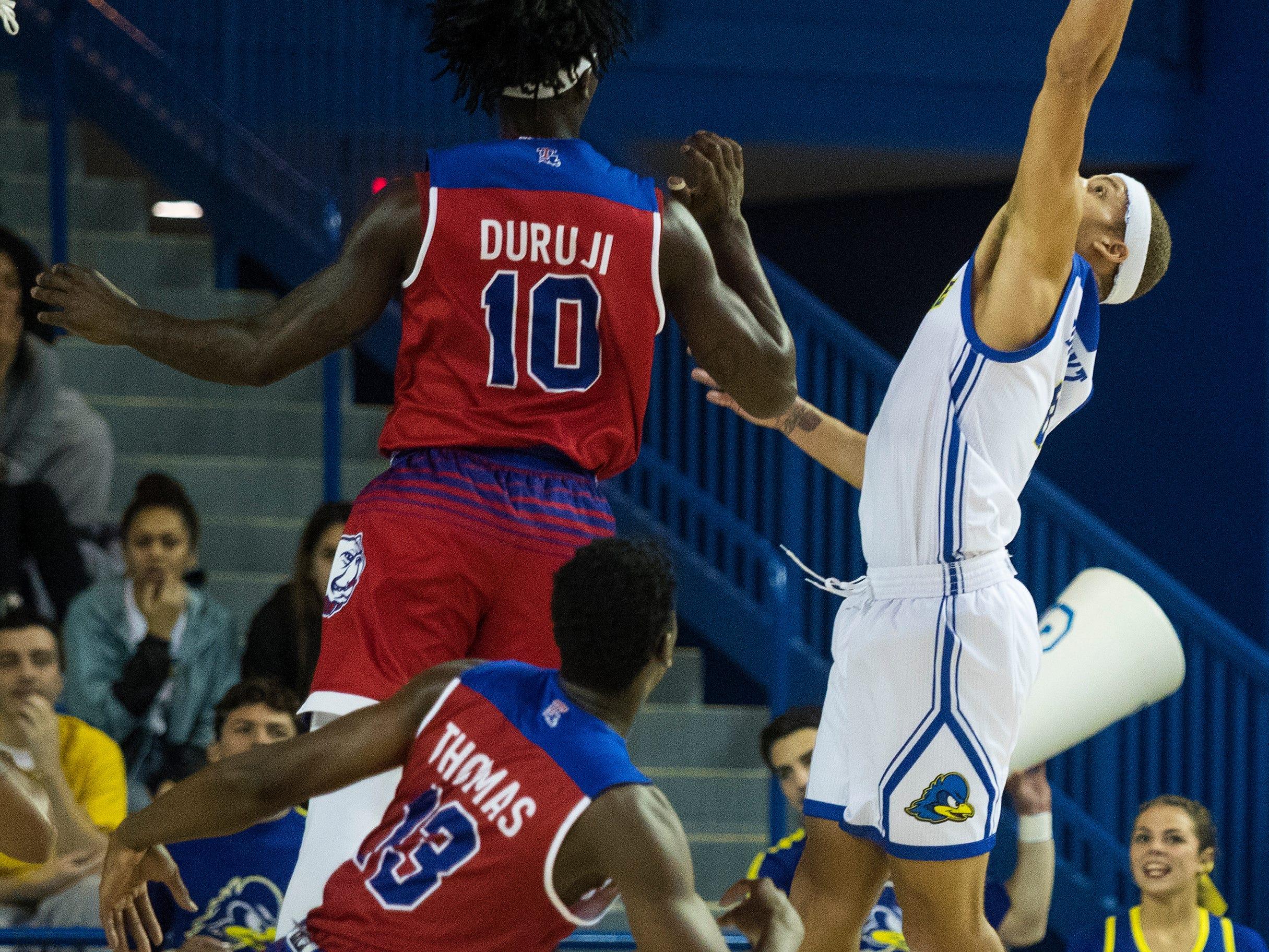 Delaware's Darian Bryant (4) reaches up for a rebound Monday at the Bob Carpenter Center. Delaware defeated Louisiana Tech 75-71.