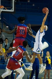 Delaware's Darian Bryant (4) reaches up for a rebound Monday at the Bob Carpenter Center. Delaware defeated Louisiana Tech 75-71.