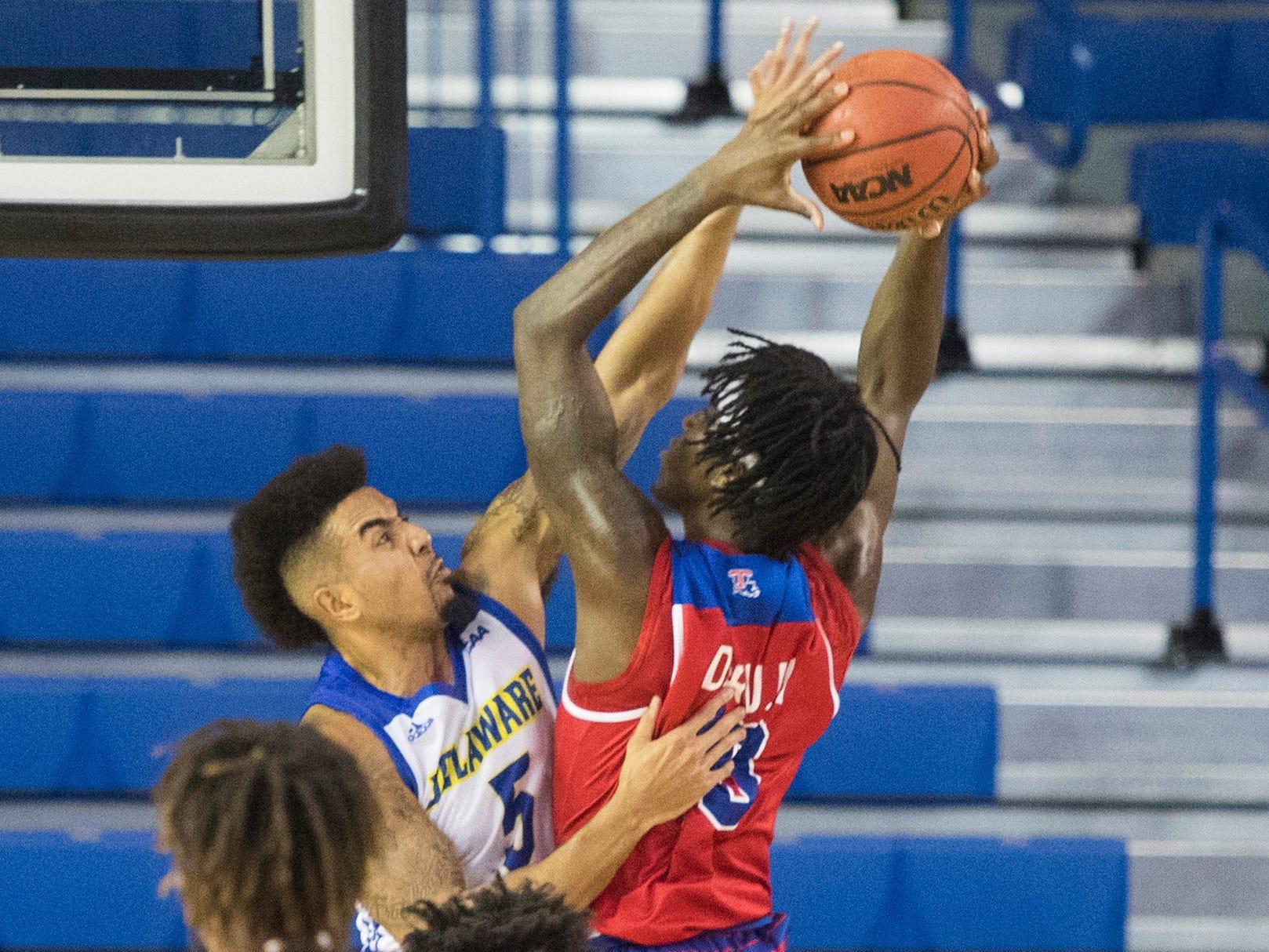 Delaware's Eric Carter (5) rises up against Louisiana Tech's  Anthony Duruji (10) Monday at the Bob Carpenter Center. Delaware defeated Louisiana Tech 75-71.