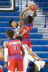 Delaware's Eric Carter (5) rises up against Louisiana Tech's  Anthony Duruji (10) Monday at the Bob Carpenter Center. Delaware defeated Louisiana Tech 75-71.