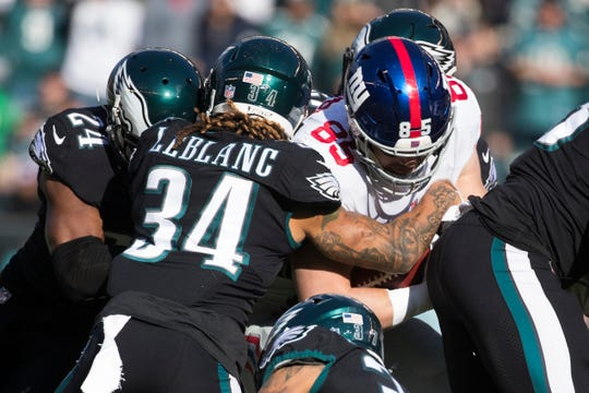 Eagles' Cre'Von LeBlanc in action Sunday against the New York Giants.