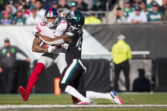 Eagles' De'Vante Bausby (41) wraps up New York's Odell Beckham Jr. Sunday at Lincoln Financial Field.