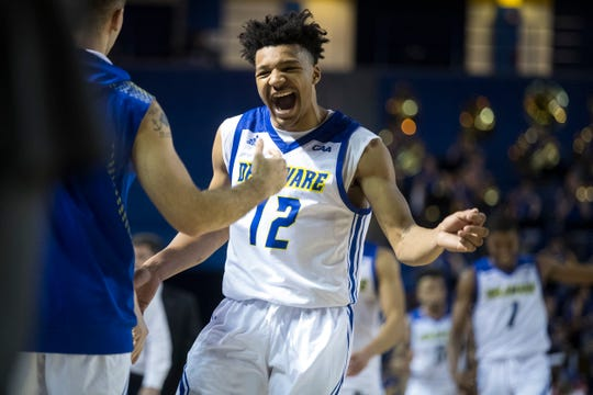 Delaware's Ithiel Horton (12) celebrates after beating Louisiana Tech 75-71 earlier this season at the Carpenter Center.