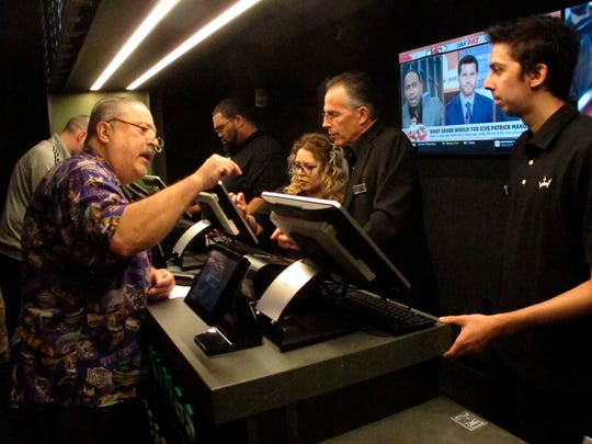 This Nov. 20, 2018, photo shows a gambler placing a sports bet at Resorts Casino in Atlantic City, N.J. Numerous U.S. states are considering joining the seven that currently offer legal sports betting. (AP Photo/Wayne Parry)