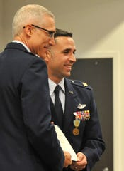 Visiting Air Force Reserve Commander, 22d Air Force, Maj. Gen. Craig La Fave, left, poses with Airman's Medal award recipient Maj. Justin Warner during a ceremony held for Warner after he rescued a family from a burning vehicle back in January.