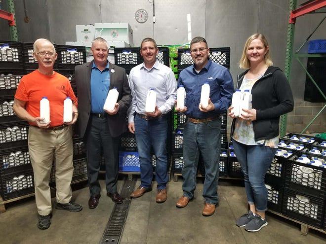 Cargill dairy team members celebrate milk donation at local food bank.
