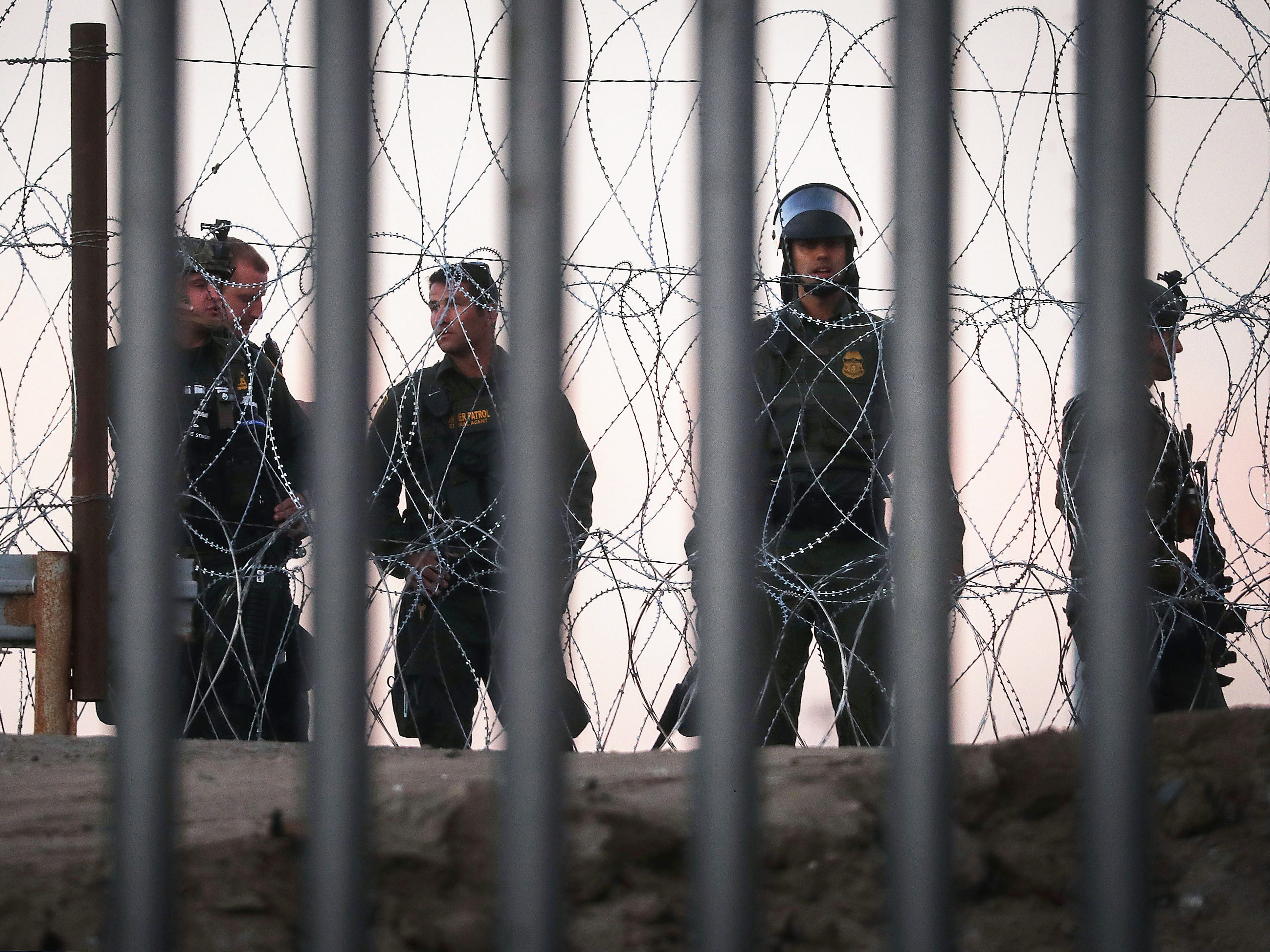 U.S. Border Patrol agents stand watch on the U.S. side of the U.S.-Mexico border fence on Nov. 26, 2018 in Tijuana, Mexico.