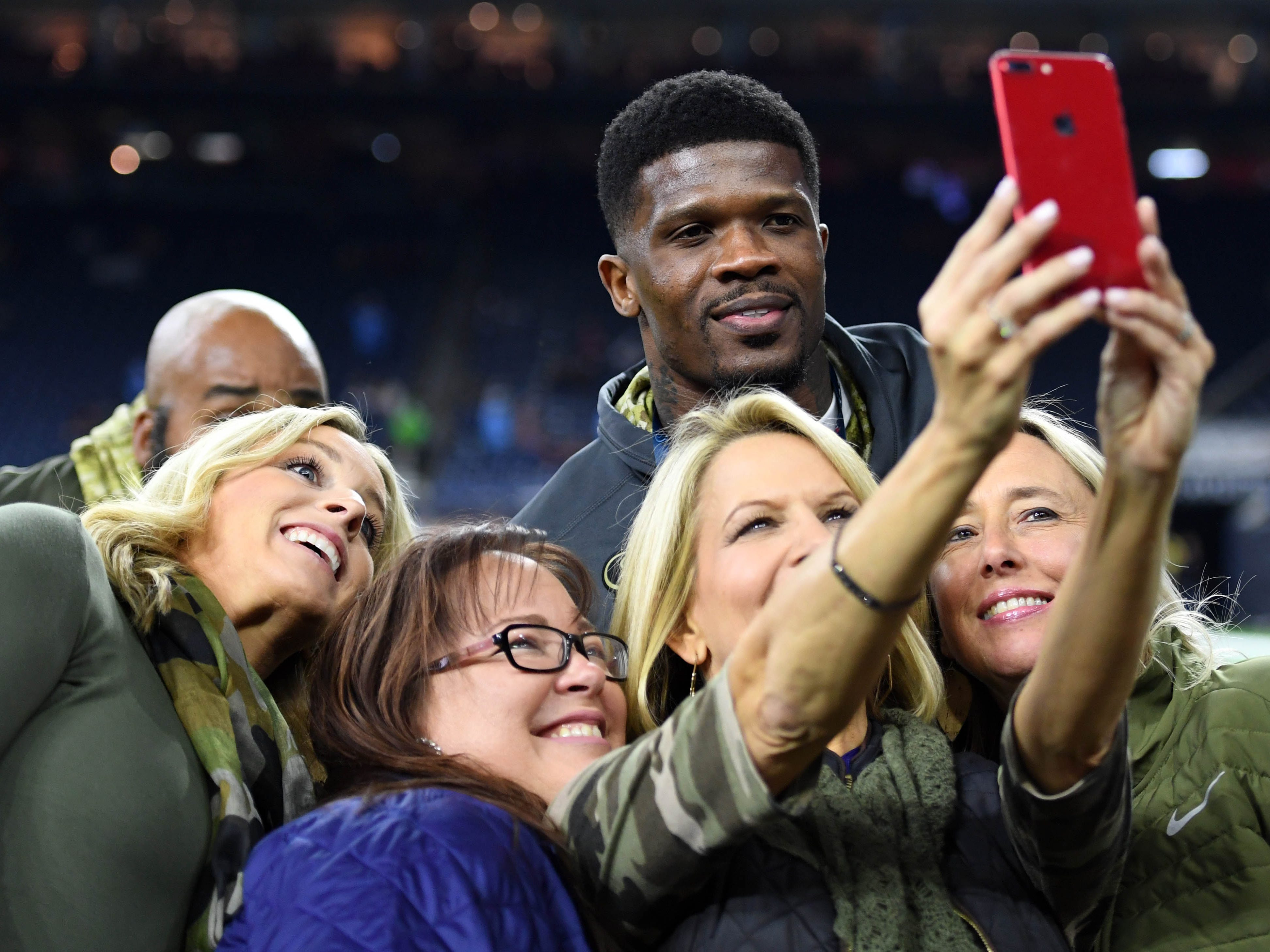 Former Houston Texans wide receiver Andre Johnson takes a photo with fans before the game against the Tennessee Titans at NRG Stadium.