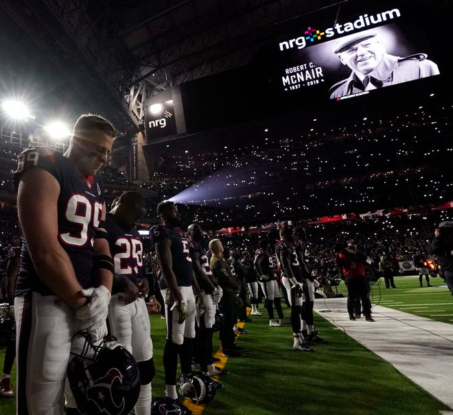 "Texans players take part in a tribute to late owner Robert ""Bob"" McNair before Monday night's game against the Titans."