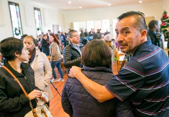 In this Dec. 13, 2017, photo Samuel Oliver-Bruno glances back before preparing for interviews after the press conference held at CityWell United Methodist Church in Durham, N.C. Oliver-Rruno, who sought refuge from deportation at the church for 11 months was arrested Friday after arriving at an appointment with immigration officials. (Casey Toth/The Charlotte Observer via AP) ORG XMIT: NCCHN201