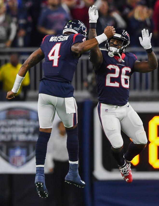 Texans quarterback Deshaun Watson (4) and running back Lamar Miller celebrate a second-quarter touchdown.