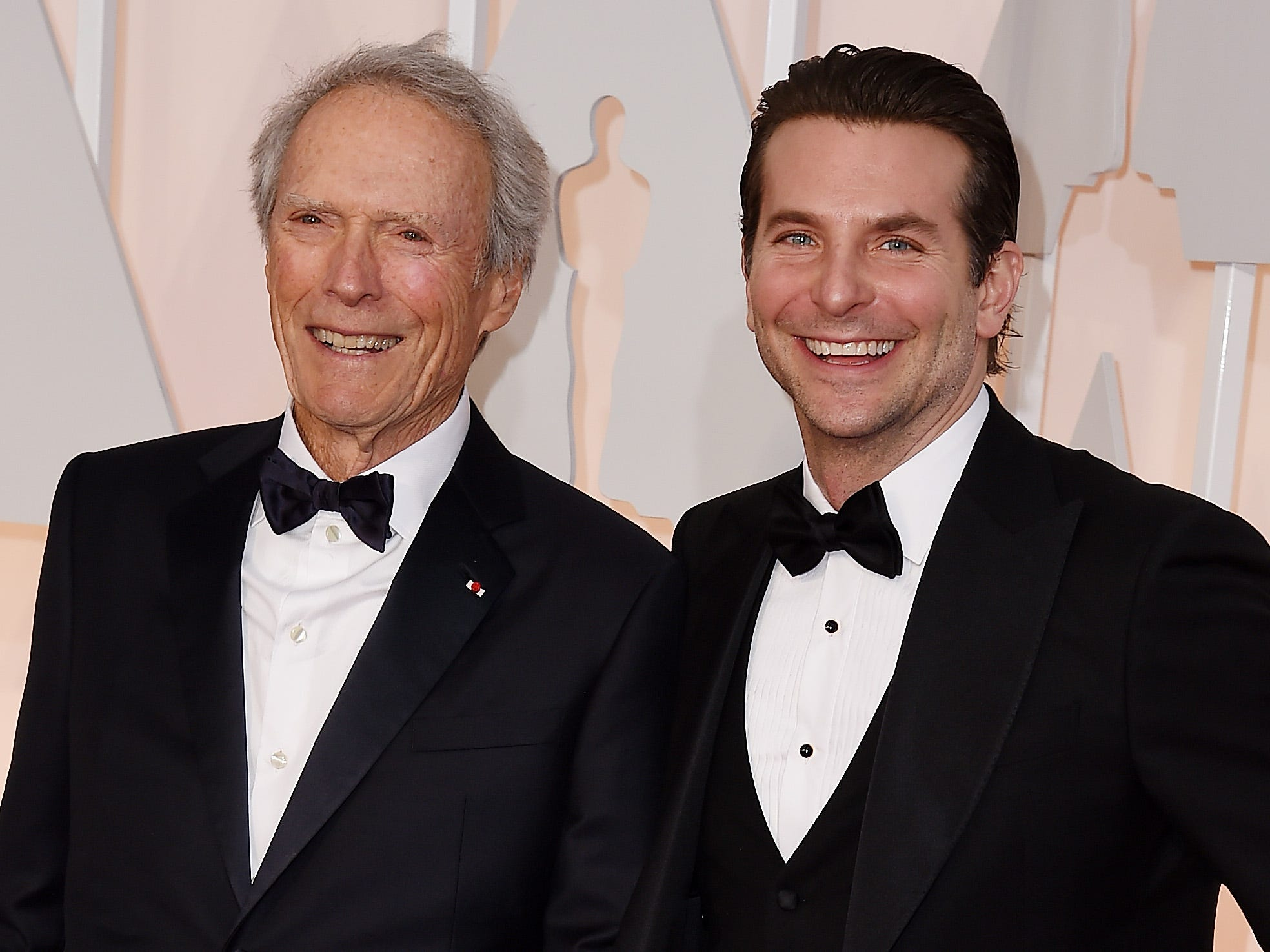 """Seen here at the 2015 Academy Awards, Clint Eastwood (left) cast his """"American Sniper"""" star Bradley Cooper as a hard-charging DEA agent in """"The Mule."""""""