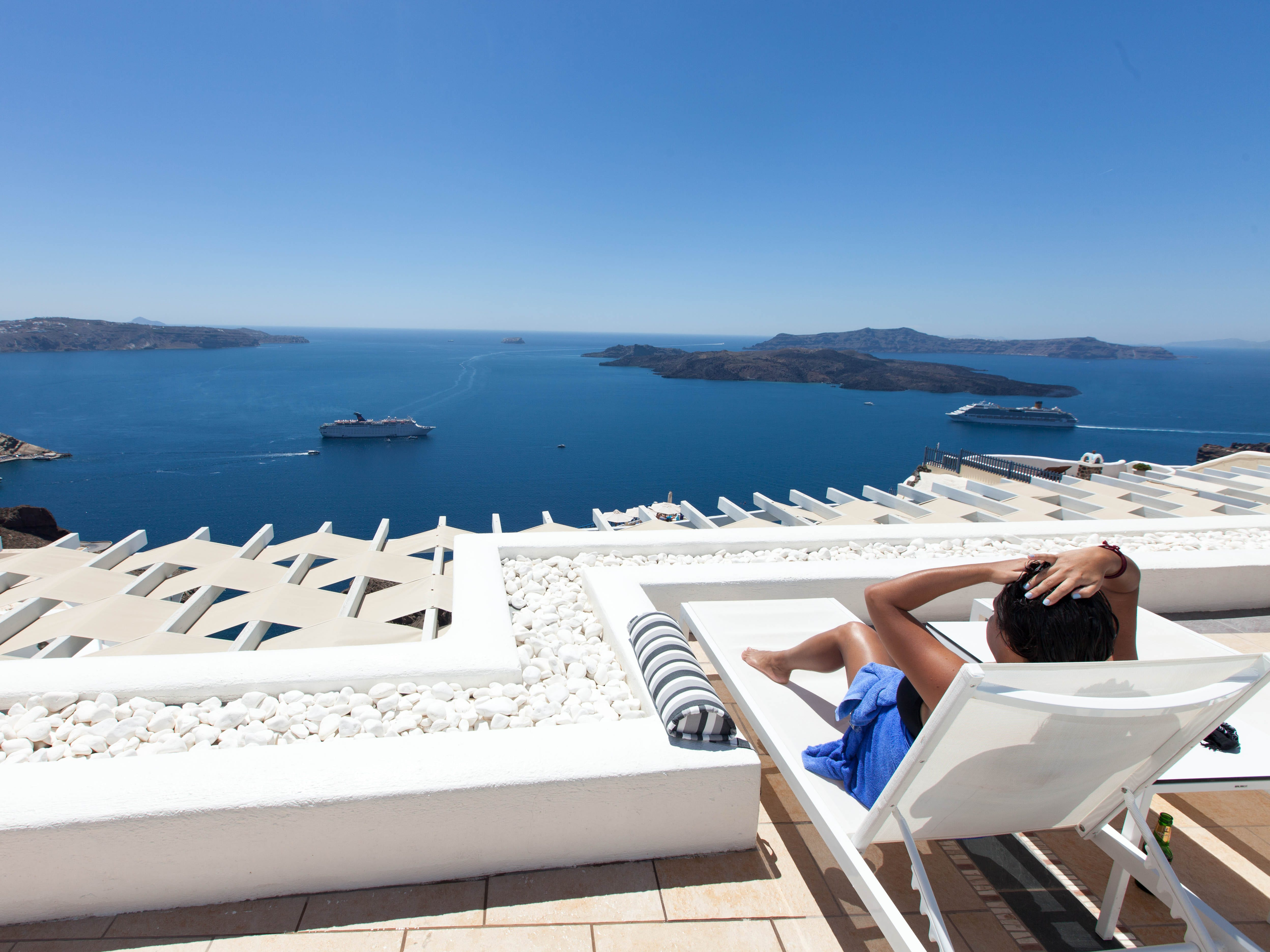 Lilium Villas Santorini: Overlooking the Aegean Sea, this boutique luxury hotel cranks up the romance factor. A gorgeous swimming pool and sun deck promise memorable moments, while the on-site spa is perfect antidote to the stress of wedding planning. The spacious rooms and black-and-white lounge and bar overlooking the water are sure impress, too, but the sunset views steal the show. Just keep in mind that a car or shuttle is necessary for exploring the rest of the island, as the hotel is a bit off the beaten path (shuttle service to the town of Fira is included in the rate, as is parking and breakfast.)