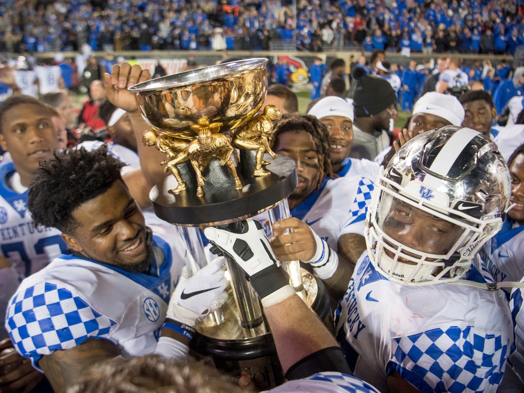 Governor's Cup: Kentucky players hoist the Governor's Cup after a 56-10 win over Louisville on Nov. 24.