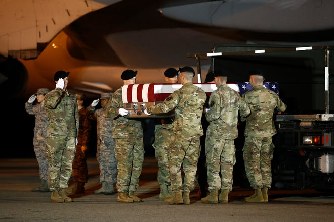 A U.S. Army carry team moves a transfer case containing the remains of Sgt. Leandro A. Jasso, Monday, Nov. 26, 2018, at Dover Air Force Base, Del. According to the Department of Defense, Jasso, 25, of Leavenworth, Wash., died Nov. 24, 2018, during combat operations in Helmand province, Afghanistan.