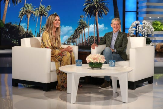 "Ellen DeGeneres chats with Heidi Klum during a taping of ""The Ellen DeGeneres Show"" in Burbank, Calif."