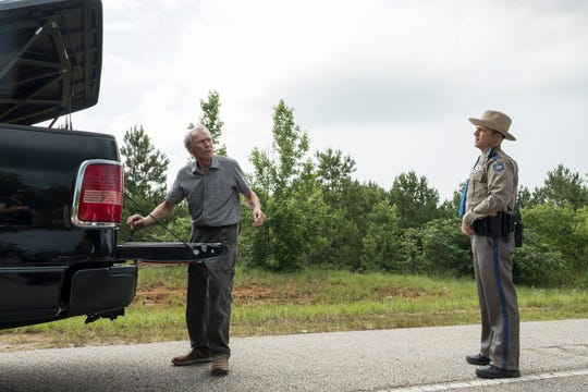 "Earl Stone (Clint Eastwood, left), carrying drugs in his truck bed, gets stopped by a Texas state trooper (Alan Heckner) in ""The Mule."""