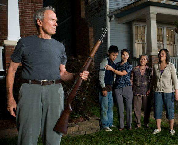 """Clint Eastwood (left) plays a Korean War vet who comes to his Asian neighbors' aid in """"Gran Torino."""""""