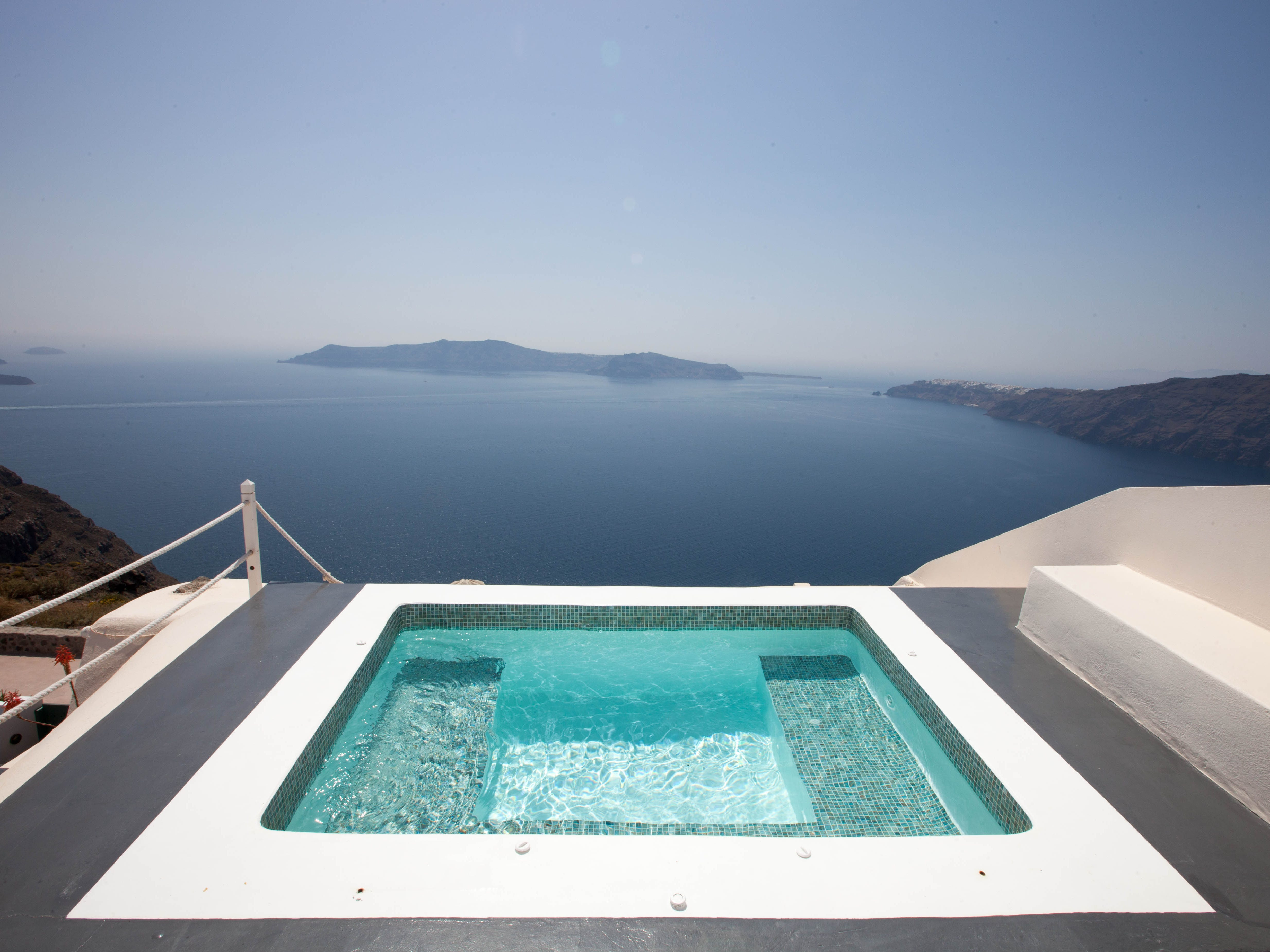 Aenaon Villas: Daydreams of a perfect honeymoon might summon images of sunny days, romantic evenings and pampering amenities. Aenaon Villas, comprised of seven luxury villas, offers it all and then some. You can expect to find the obligatory infinity pool overlooking the sea, plus traditional Cycladic design, including a gleaming white exterior.