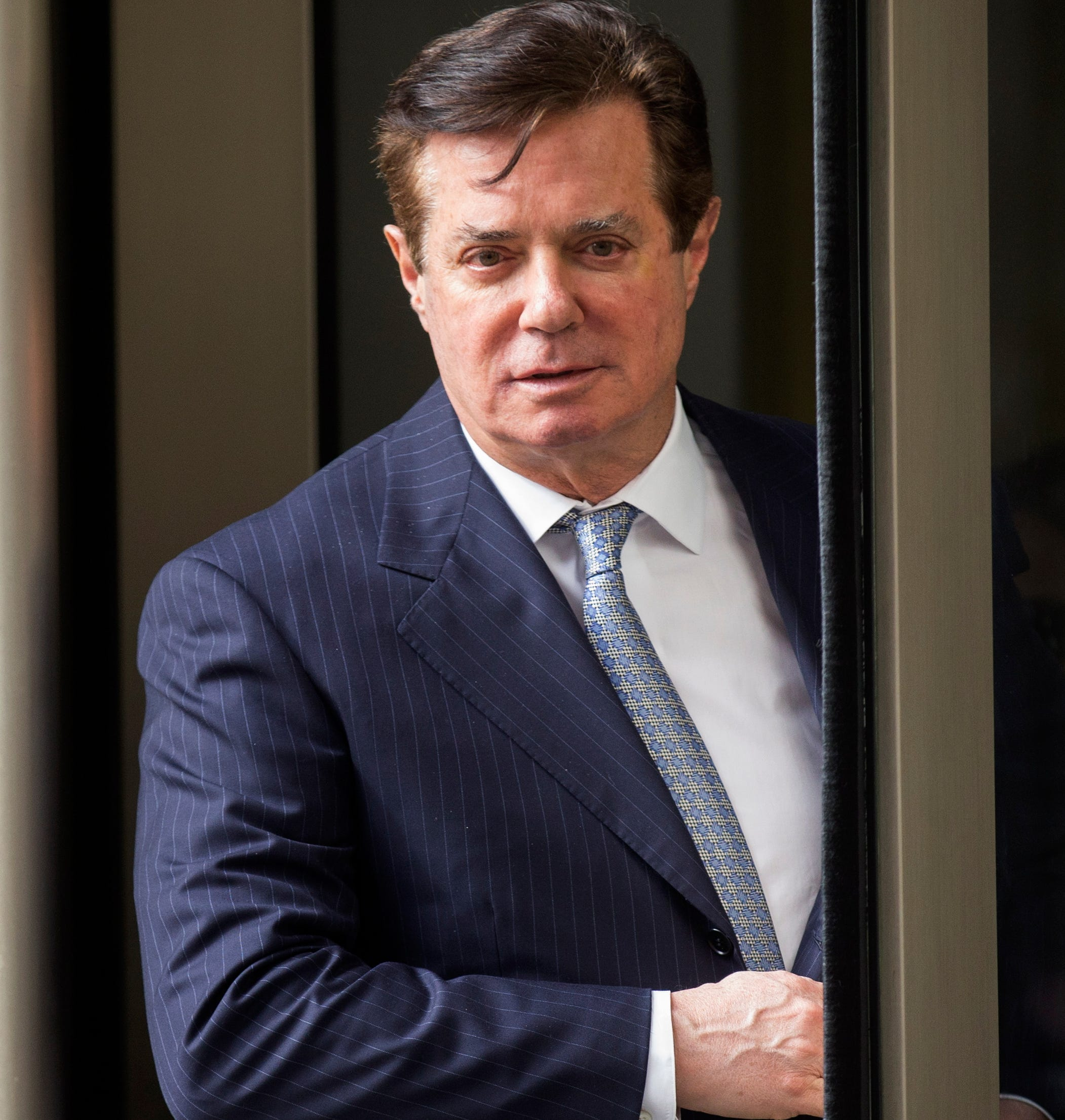 Former Trump campaign chairman Paul Manafort departs the federal court house after a status hearing in Washington, DC, earlier this year.