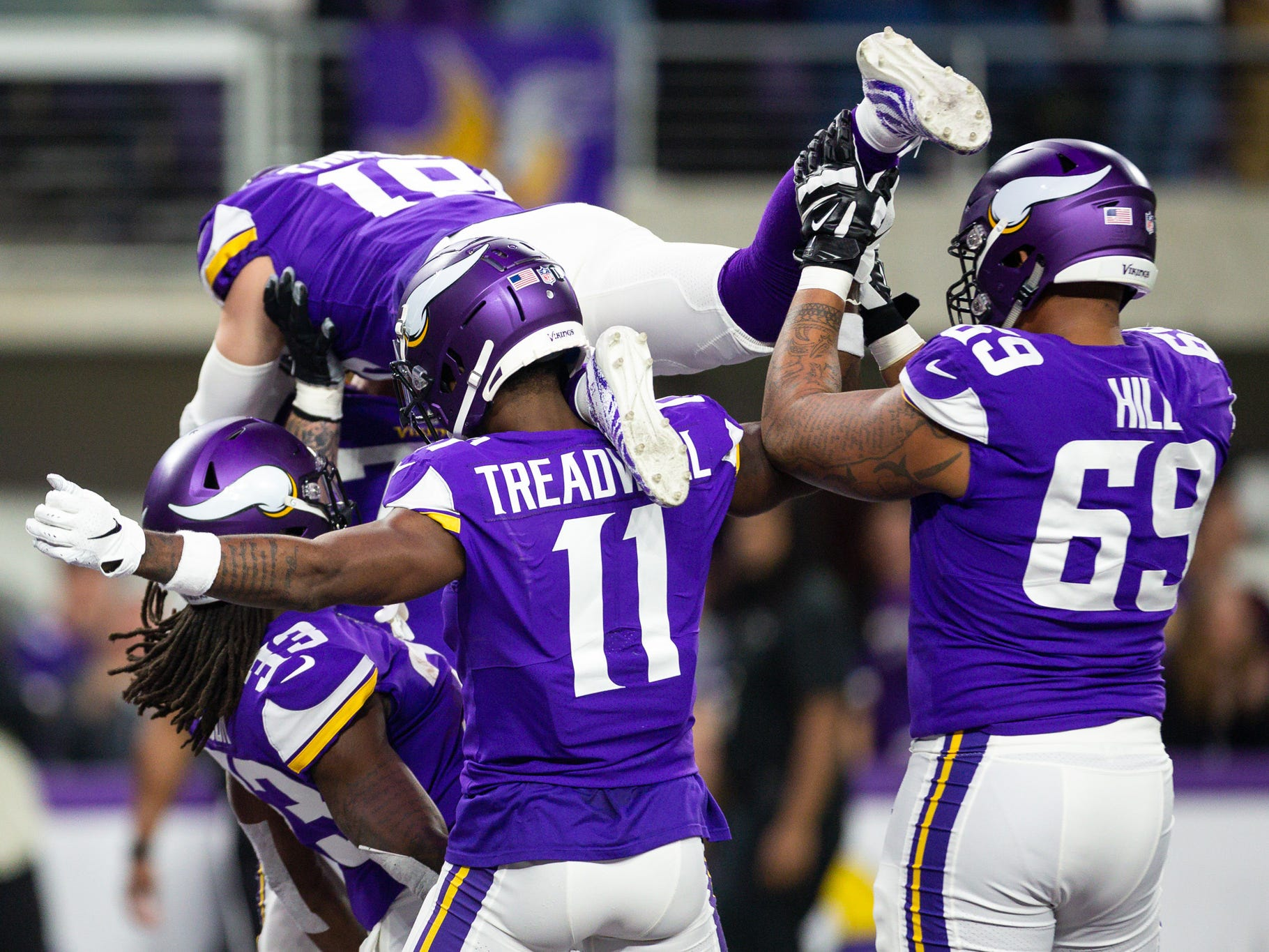 Minnesota Vikings running back Dalvin Cook (33) celebrates with teammates after scoring a touchdown during the second quarter against the Green Bay Packers at U.S. Bank Stadium.