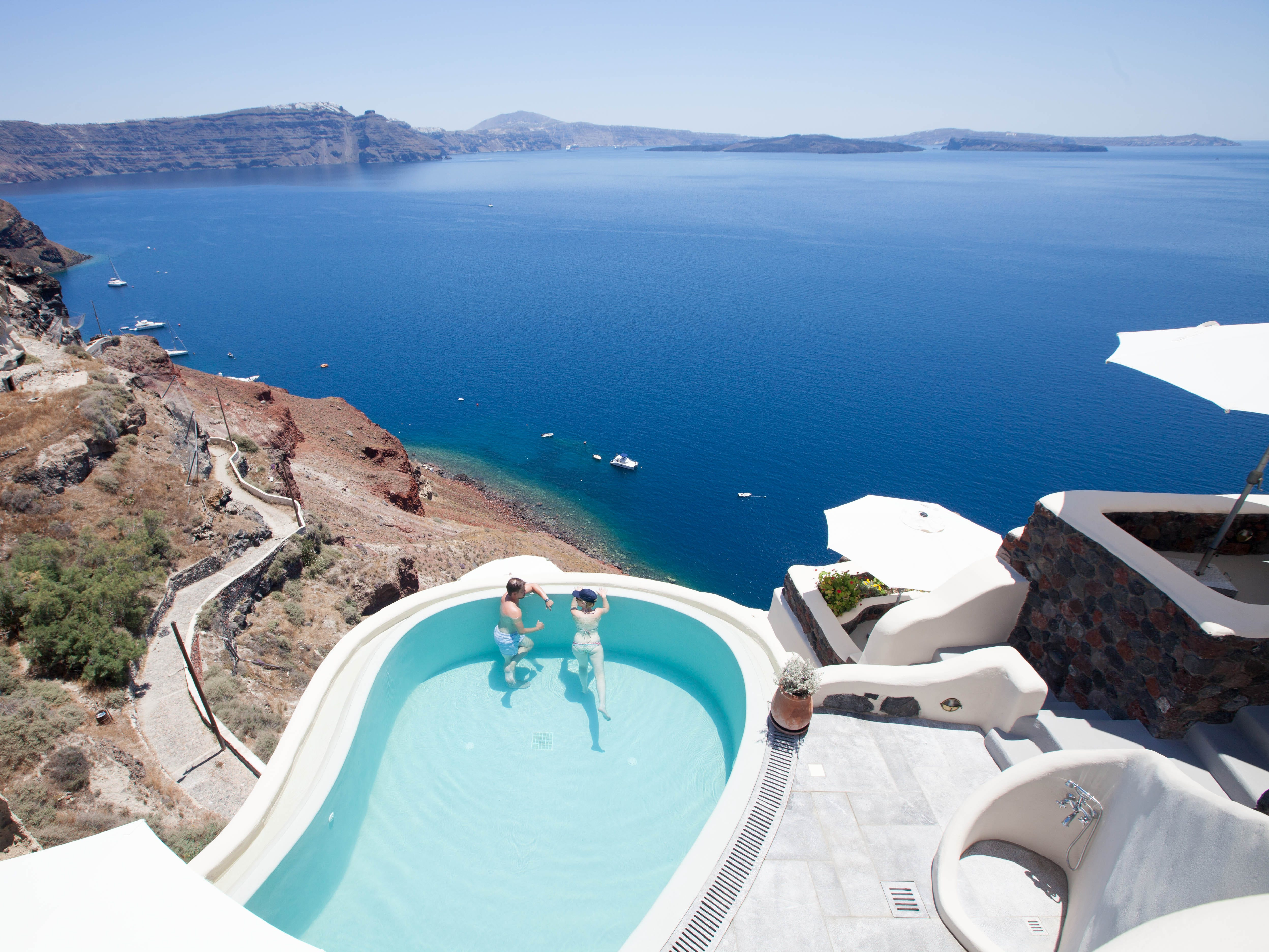 Pezoules: It's tough not to fall in love with and in Pezoules, a six-room knockout set a few steps from Oia. Set up for beautiful views along the lower caldera cliffs, the property is small and quiet – save for a few people and donkeys – making it prime for honeymooning couples seeking some solitude. Many of the rooms sport that Instagram-worthy Santorini style (think cave-like accommodations with whitewashed walls), though it's the picture-perfect infinity pool that will keep the spark alive.