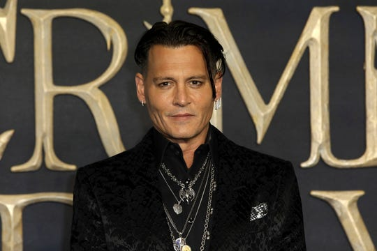 """Actor Johnny Depp at the premiere of """"Fantastic Beasts: The Crimes of Grindelwald,"""" in London on Nov. 13, 2018."""