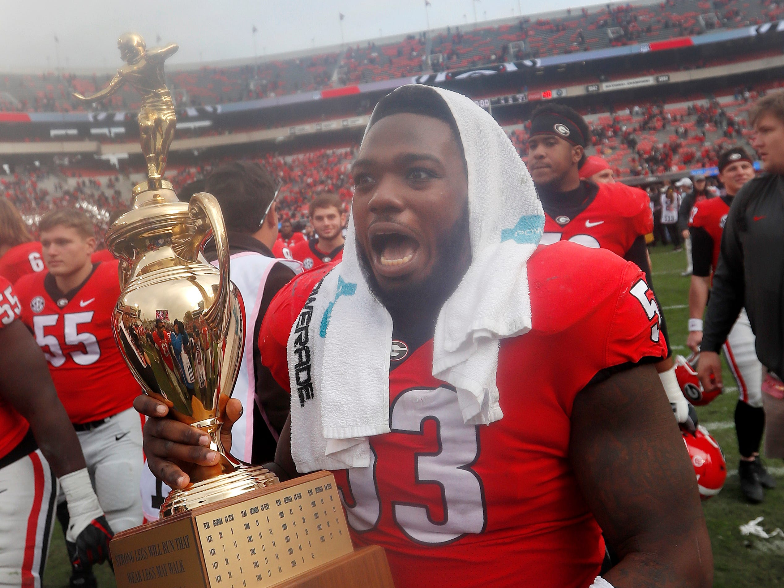 Governor's Cup: Georgia center Lamont Gaillard (53) reacts as he carries the Governor's Cup off the field after defeating Georgia Tech, 45-21, in  Athens, Ga., on Nov. 24.