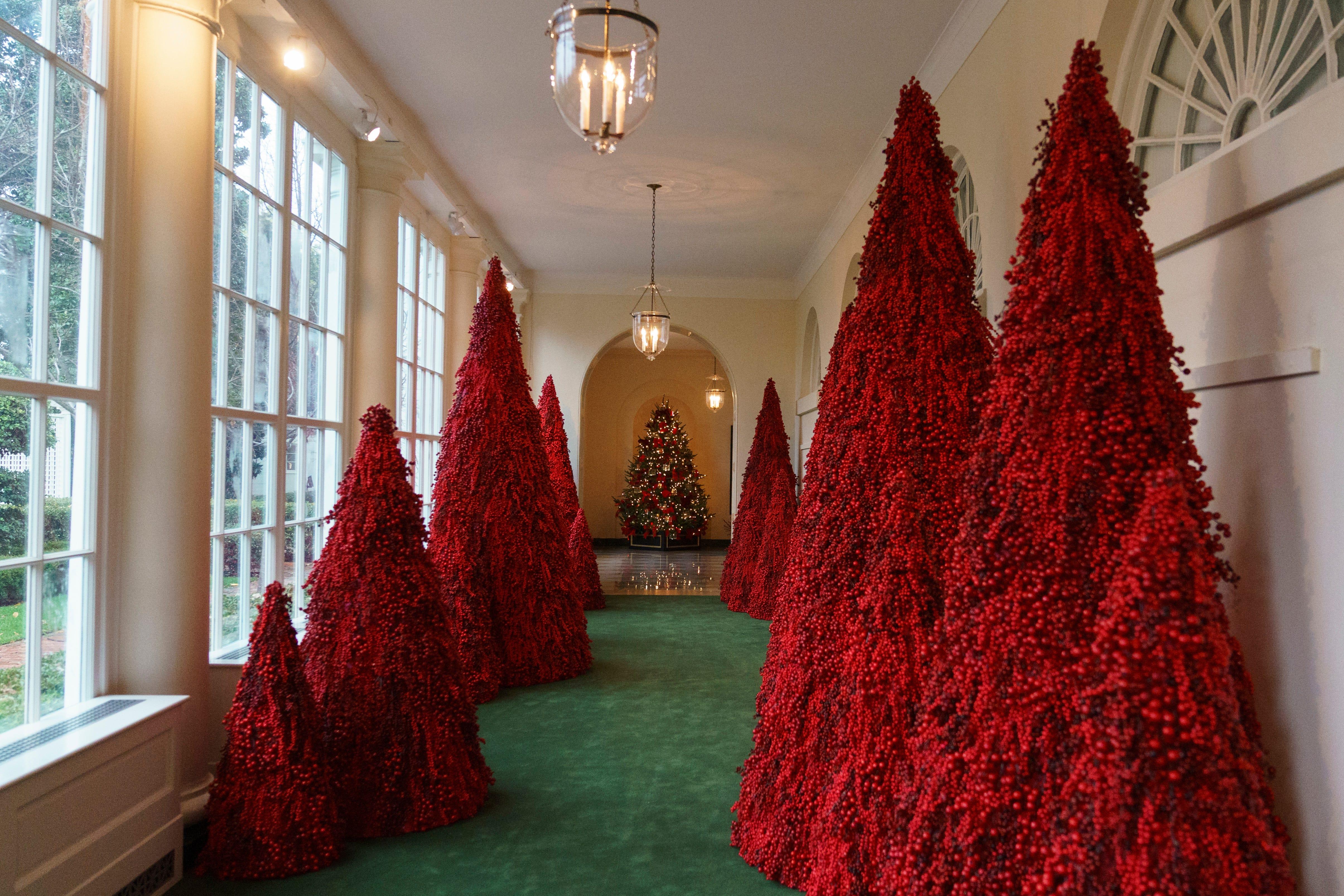 Melania Trump defends red Christmas trees that have Twitter crying  u0027Handmaidu0027s Taleu0027
