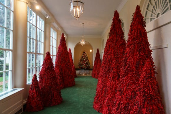 Red topiary trees are part of the White House's 2018 Christmas decorations, which were unveiled by first lady Melania Trump on Monday, Nov. 26.